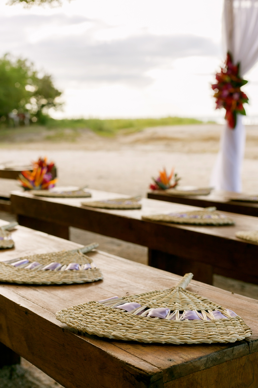 rustic ceremony with fans on benches