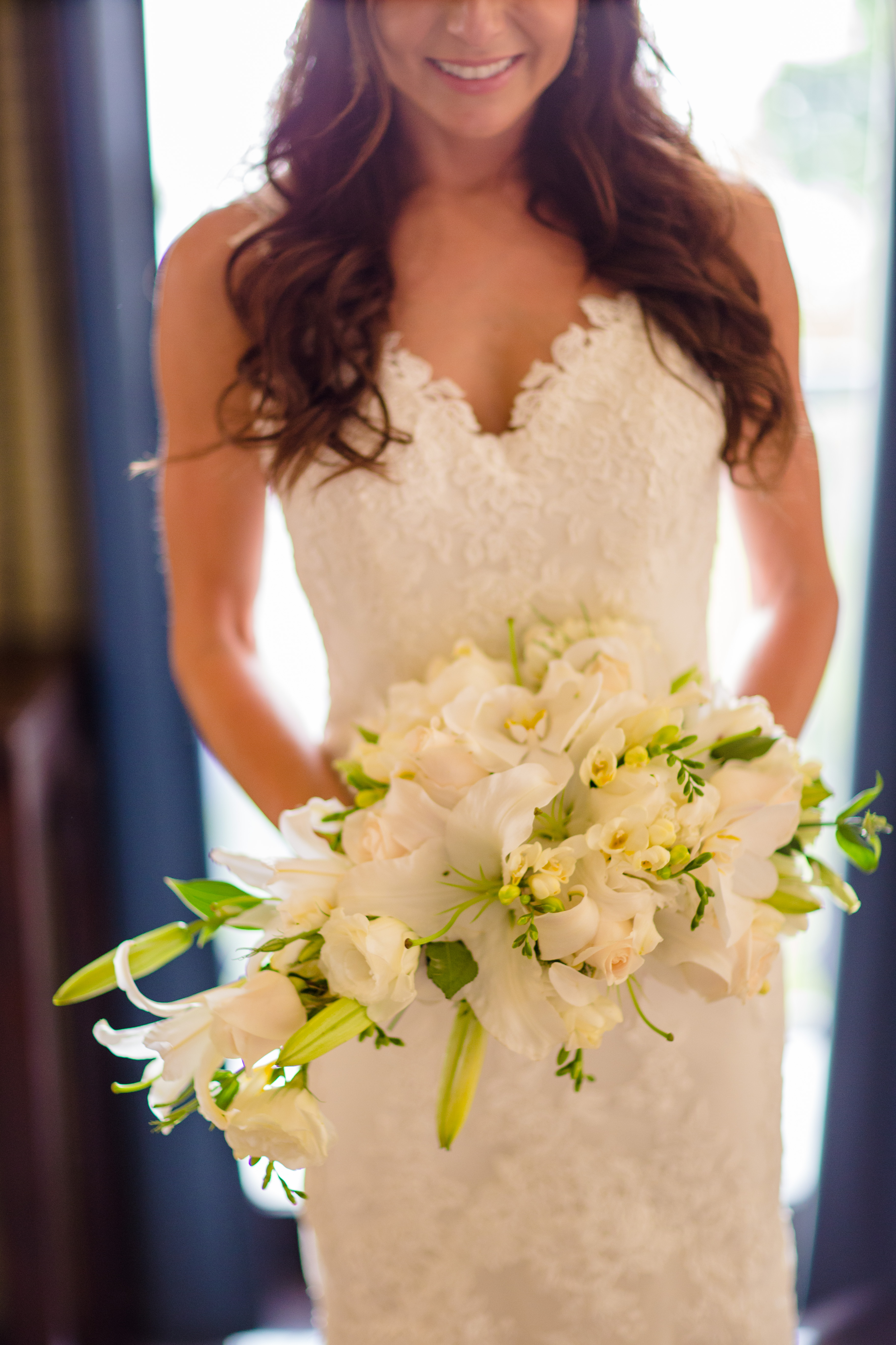 cascading bouquet white lilies and roses