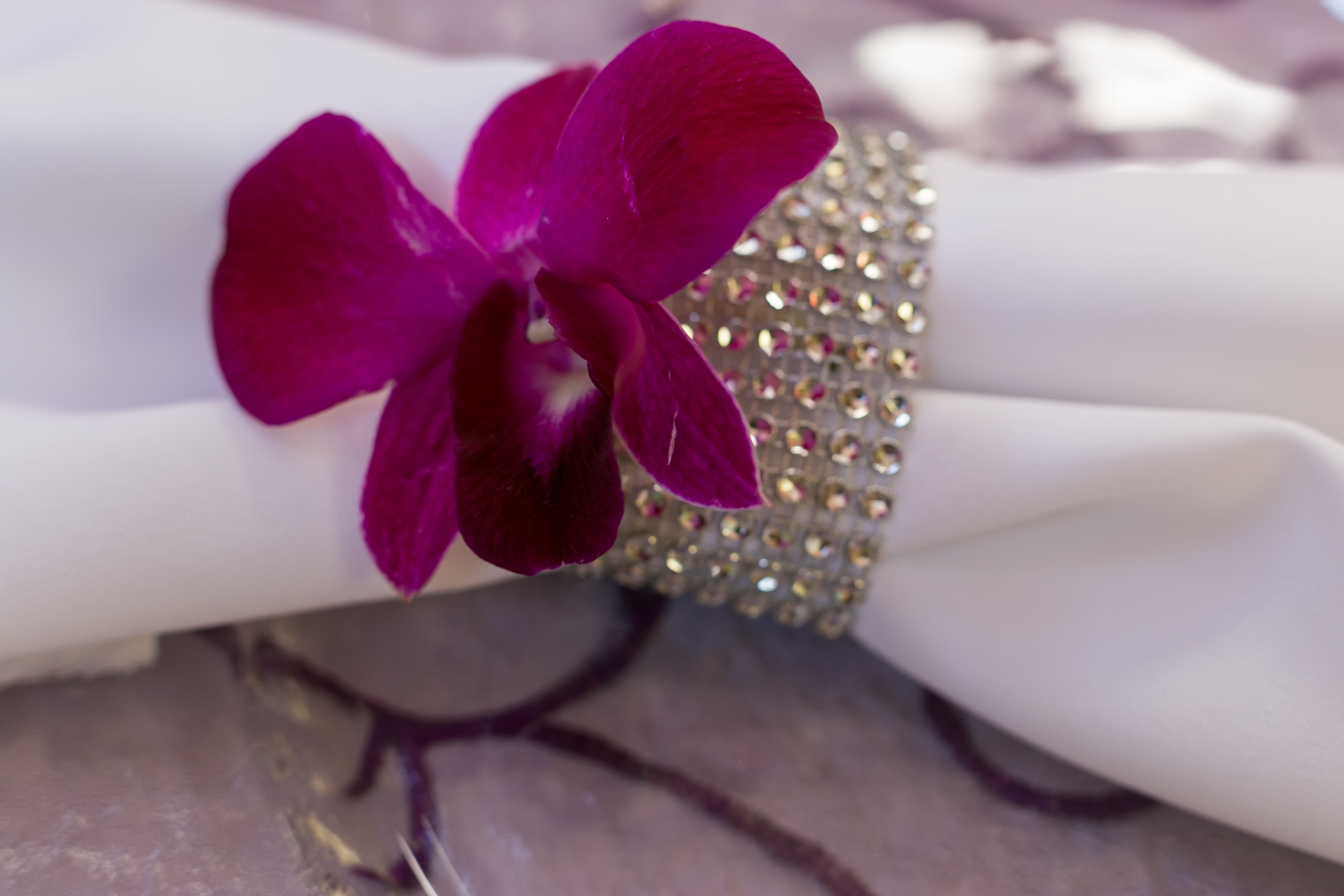 silver napkin ties with orchid