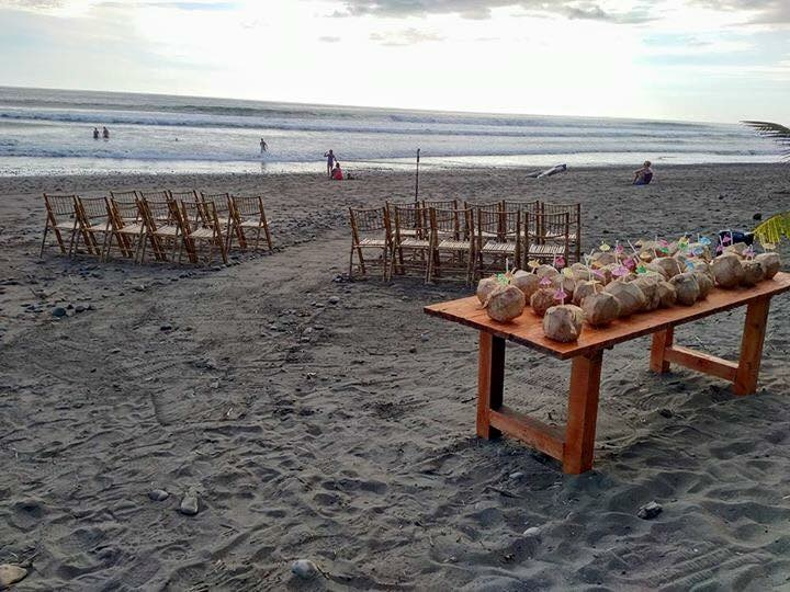 domical beach costa rica wedding set up with coconuts