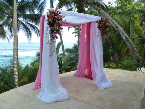 canopy with floral arrangements