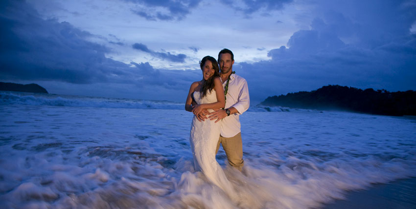 Couple, bride and groom, married in Manuel Antonio Costa Rica in all inclusive wedding at the beach
